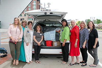 KEHA members load donated items for transportation to the Center for Couragous Kids