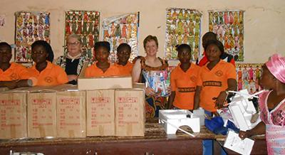 Kim Spillman and Marcia Rasner deliver sewing machines to the sewing  cooperative in the village of b76db4ec866