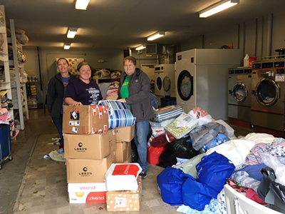 The donated quilts and pillowcases arrive at the Center for Courageous Kids laundry facility